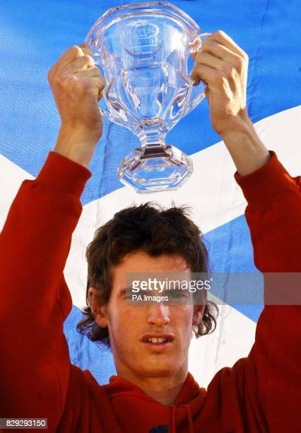 British tennis sensation Andrew Murray celebrates his victory in the boys' US Open on his arrival back in Scotland The 17yearold beat Ukrainian...