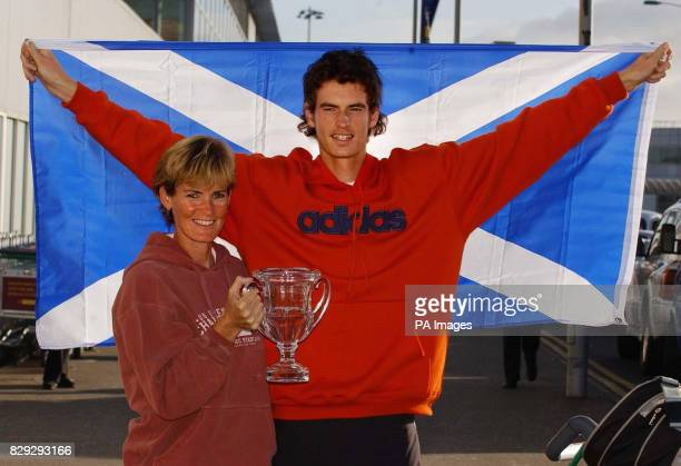British tennis sensation Andrew Murray celebrates his victory in the boys' US Open with his mum Judy on his arrival back in Scotland The 17yearold...