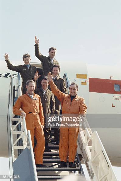 British test pilots Brian Trubshaw and John Cochrane pictured with their technical flight team on the steps in front of the British built Concorde...