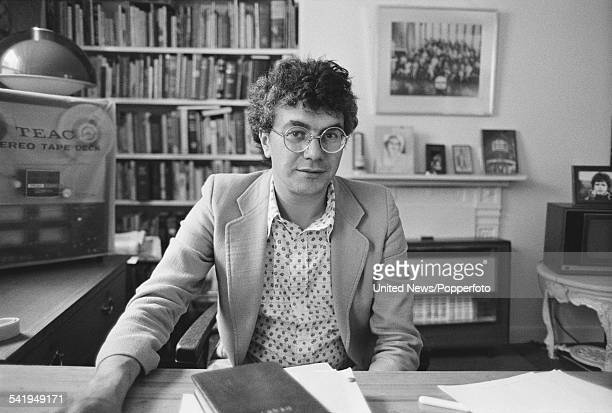 British theatre impresario and film producer Michael White pictured at a desk in London on 28th July 1976