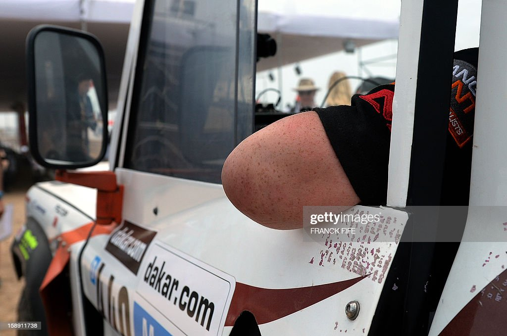British Thomas Neathway, of the team Race 2 Recovery consisting of British and American soldiers who have suffered serious injuries in the conflicts in Iraq and Afghanistan in recent years, waits in his car in Lima on January 3, 2013, ahead of the 2013 Dakar Rally which this year will thunder through Peru, Argentina and Chile from January 5 to 20.