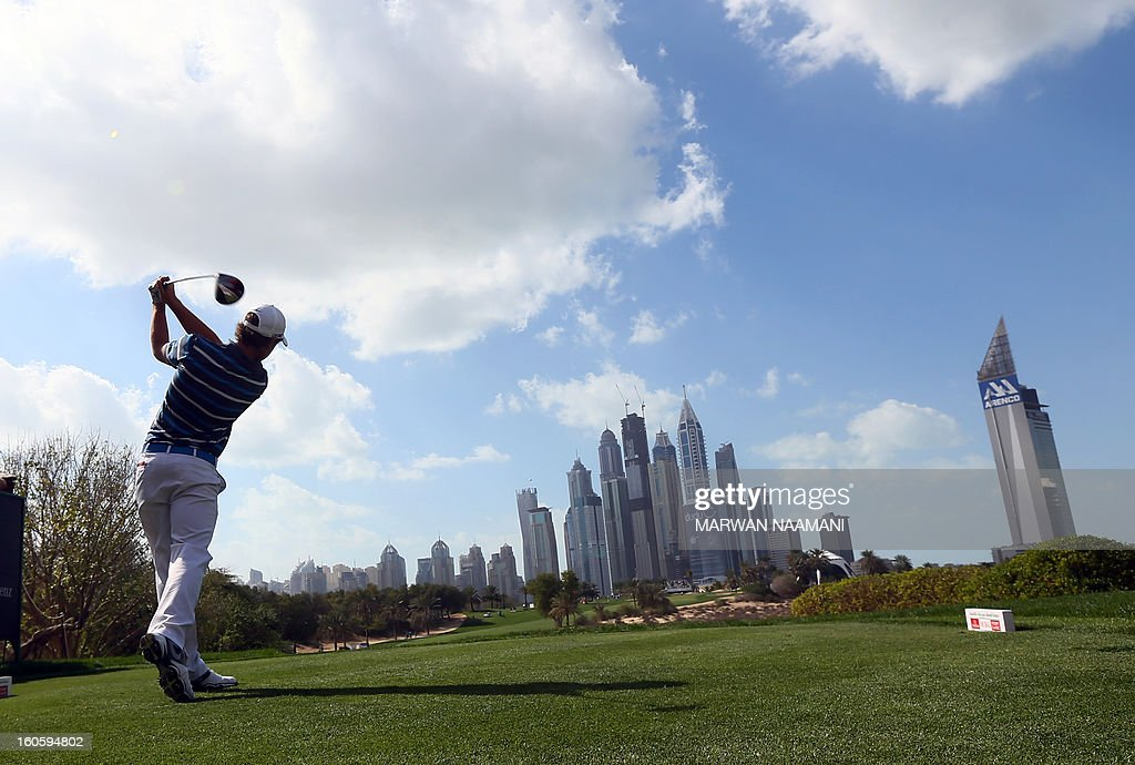 British Tommy Fleetwood tee off on the fourth and last round of the Omega Dubai Desert Classic in Dubai, on February 3, 2013. British Robert Rock plays a shot from the bunker on the fouth and last round of the Omega Dubai Desert Classic in Dubai, February 03, 2013.