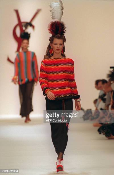 British top model Kate Moss presents a creation of French designer Yves Saint Laurent 13 October 1993 in Paris during the spring/summer 93/94 ready...