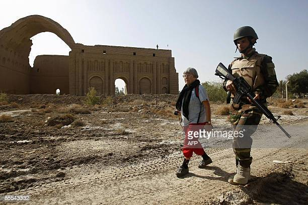British tourist Bridgett Jones walks with an Iraqi police commando during a visit to the Castle of Persian King Xerxes at Salman Pak south of Baghdad...