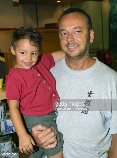 British tourist John Reynolds holds three yearold Lola Bellieni from Notting Hill after arriving at Heathrow from Sri Lanka's International Airport *...