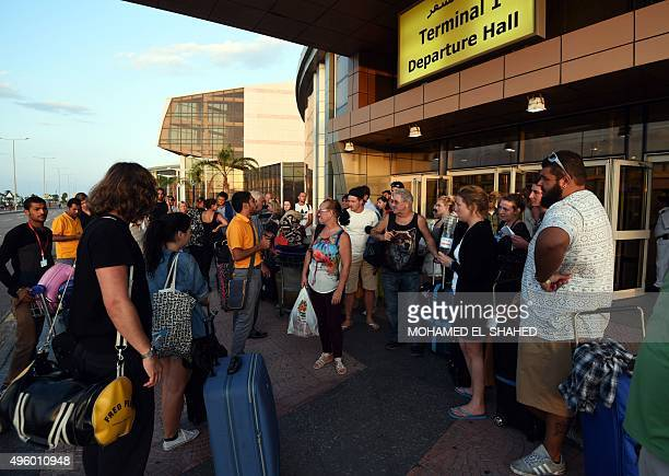 British tourists arrive at the airport in Egypt's Red Sea resort of Sharm ElSheikh on November 6 2015 Britain moved to repatriate thousands of...