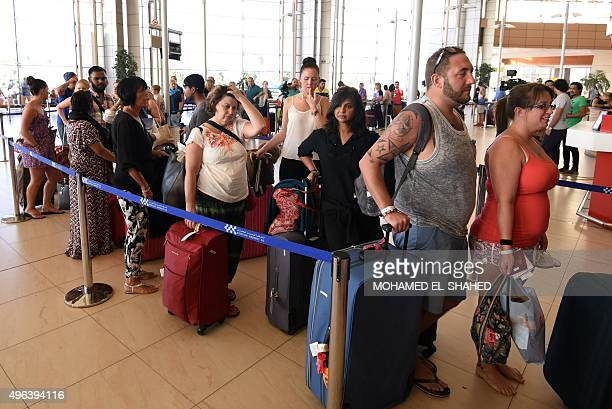 British tourists arrive at the airport in Egypt's Red Sea resort of Sharm ElSheikh on November 9 2015 Tens of thousands of Russians and Britons were...