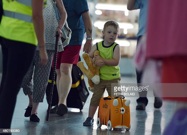 British tourists arrive at the Enfidha International airport in the Tunisian capital Tunis on July 10 2015 after the British Foreign Office advised...