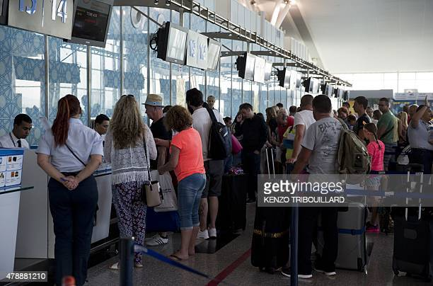 British tourists queue up at the checkin counter at the Enfidha International airport on June 28 as they leave Tunisia two days after a shooting...