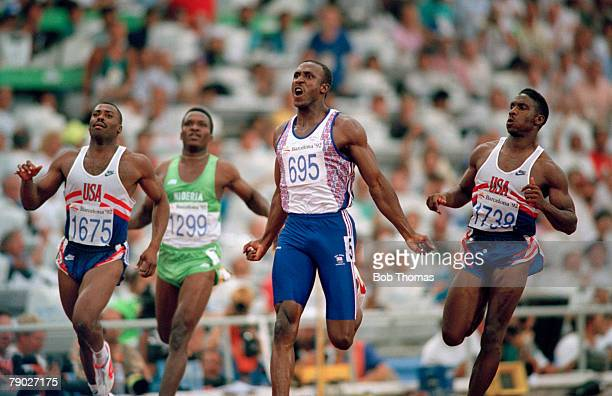 British track and field athlete Linford Christie of the Great Britain team crosses the finish line in first place to win the gold medal in the final...