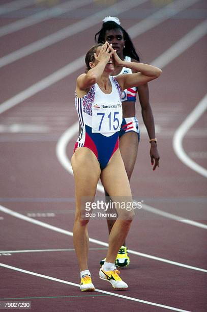 British track and field athlete Sally Gunnell of the Great Britain team raises her hands to her head after crossing the finish line in first place to...