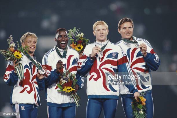 British track athletes from left Jamie Baulch Mark Richardson Iwan Thomas and Roger Black of the Great Britain team celebrate on the medal podium...