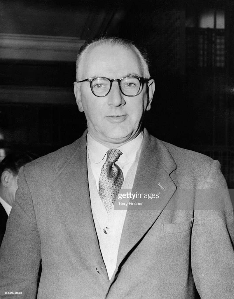 British trade union leader Frank Cousins (1904 - 1986) leaving a meeting at Transport House, London, 15th March 1957. As General Secretary of the Transport and General Workers' Union, he has been involved in discussions over a shipbuilding dispute.