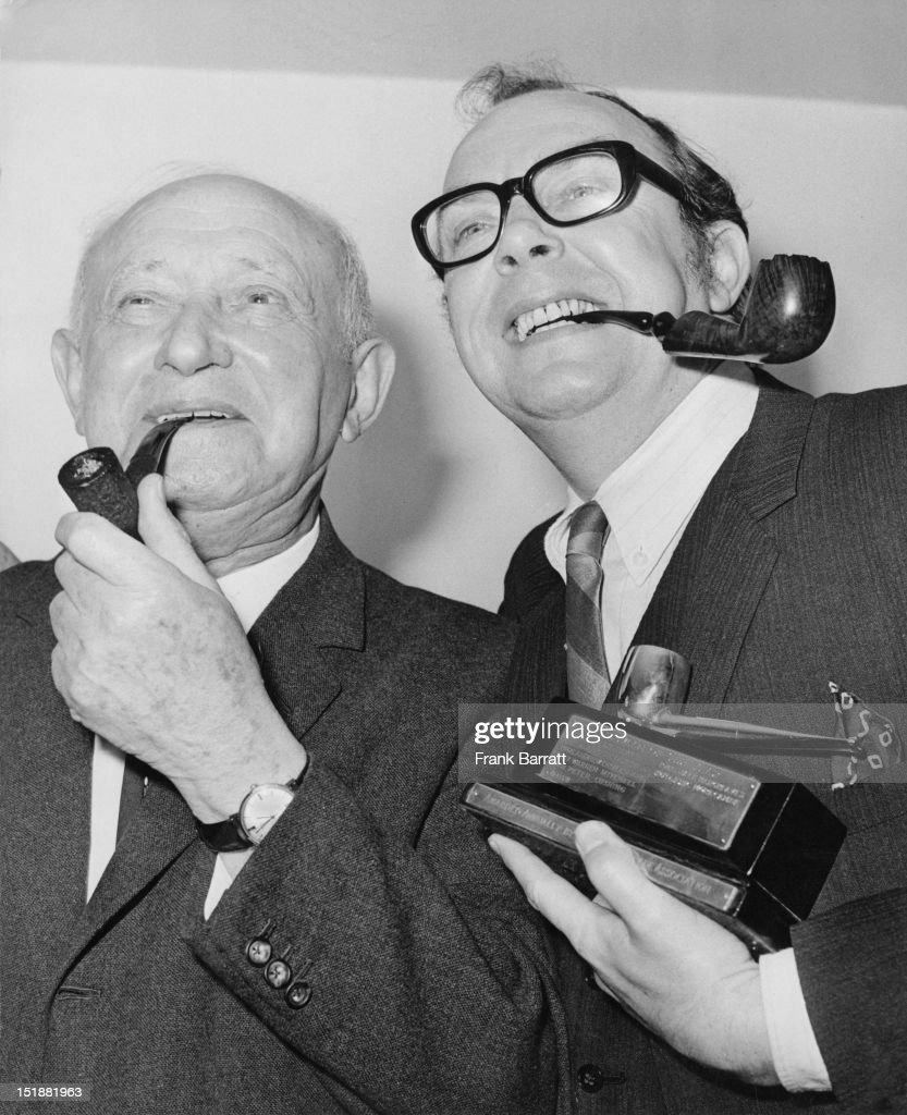 British trade unionist and politician Manny Shinwell, Baron Shinwell (1884 - 1986, left) with English comedian <a gi-track='captionPersonalityLinkClicked' href=/galleries/search?phrase=Eric+Morecambe&family=editorial&specificpeople=215236 ng-click='$event.stopPropagation()'>Eric Morecambe</a> (1926 - 1984) at the 'Pipeman of the Year' awards at the Savoy Hotel, London, 20th January 1971. The award was given to Morecambe by 'Tobacco' magazine and the Briar Pipe Association. Shinwell was runner-up.