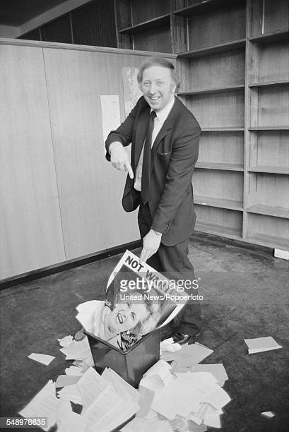 British trade unionist and president of the National Union of Mineworkers Arthur Scargill pictured placing a 'Not Wanted' poster of Prime Minister...