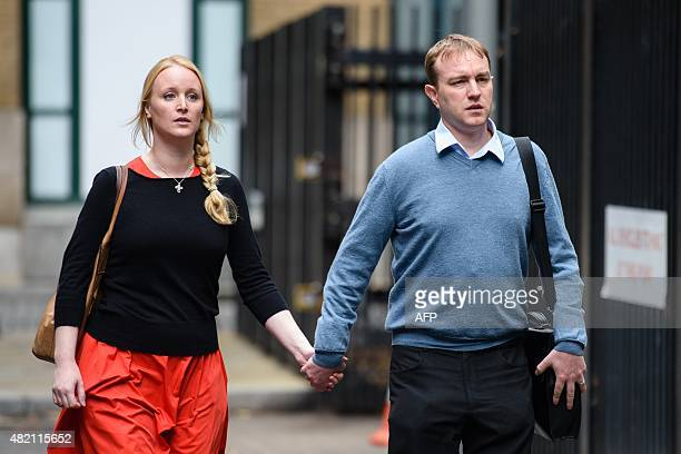 British trader Tom Hayes arrives at Southwark Crown court with his wife Sarah in London on July 27 2015 as the trial over alleged rigging of the...