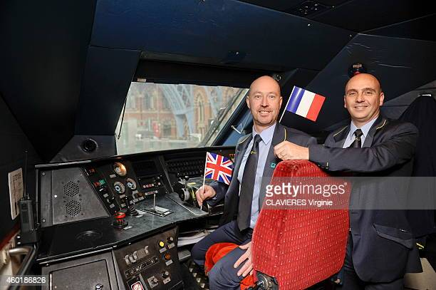 British train driver Alan Pears and the french one Sebastien Soulie pose with their country flag at Saint Pancras station for the 20 of the Eurostar...