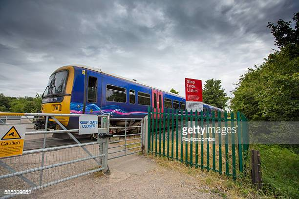 British train zooming past a level crossing