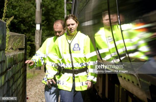 British Transport Police Constable Rebecca Lamb and her colleague PC Ian Gathercole check for signs of vandalism besides the railway line as they...