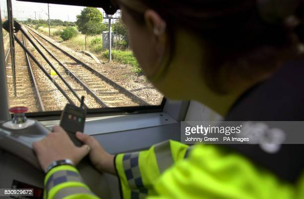 British Transport Police Constable Rebecca Lamb looks ahead onto the railway lines as she travels aboard a c2c QTrain between Barking and LeighonSea...