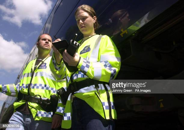British Transport Police Constable Rebecca Lamb makes notes as her colleague PC Ian Gathercole looks on as they travel aboard a C2C QTrain between...