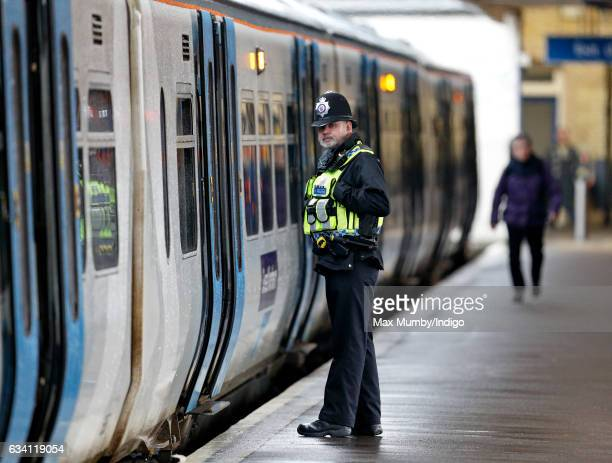 A British Transport Police Officer patrols the platform at King's Lynn Railway Station ahead of Queen Elizabeth II's departure to London after her...