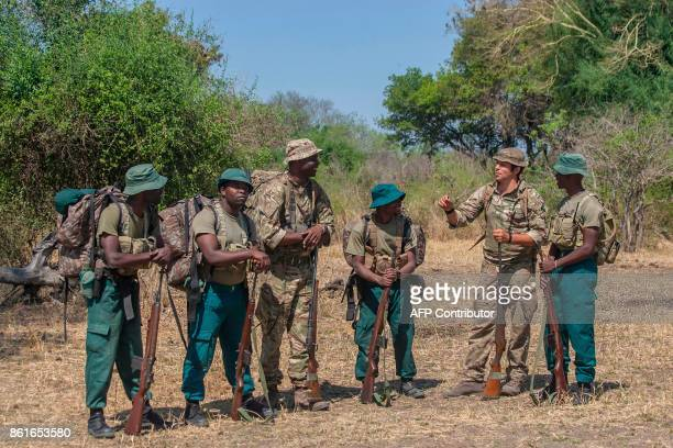 British trooper and Counter Poaching Operator Samuel Knuckey and Malawian born British soldier Sergeant and Counter Poachinh Operator Kingsley...
