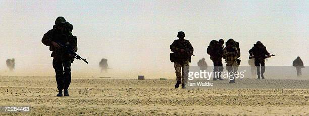 British troops from 51 Squadron Royal Air Force Regiment march through the desert during training March 11 2003 in the Kuwaiti desert near the Iraqi...
