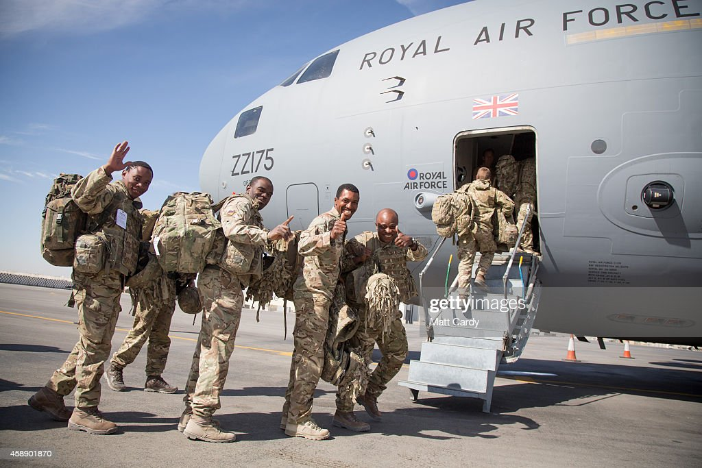 British troops gesture as the board a RAF C17 as they leave Afghanistan to go home at Kandahar airfield on November 13 2014 in Kandahar Afghanistan...