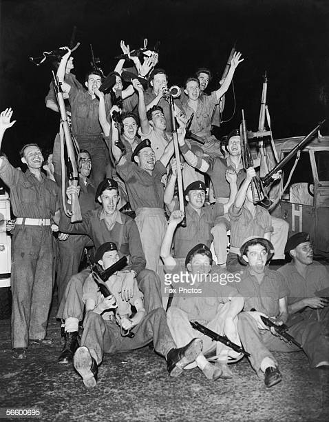British troops in Port Said Egypt celebrate the announcement by British Foreign Secretary Selwyn Lloyd that Allied forces are to be withdrawn from...