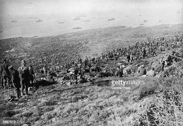 British troops of the IX Corps scattered over a coastal hillside after landing at Suvla on the Aegean coast of the Gallipoli peninsula in Turkey...