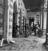 British troops searching a war damaged building in Egypt during the Suez Crisis November 1956