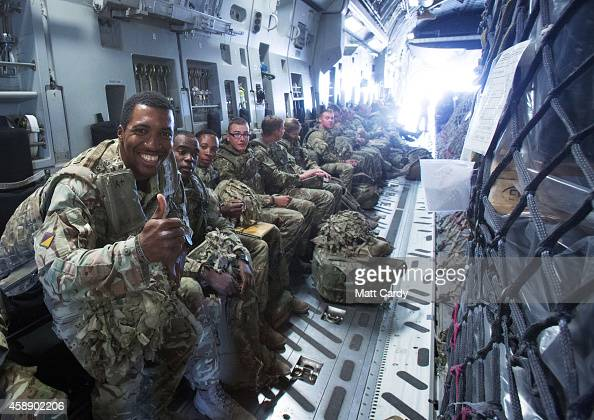 British troops sit on board a RAF C17 as they leave Afghanistan to go home at Kandahar airfield on November 13 2014 in Kandahar Afghanistan Now that...