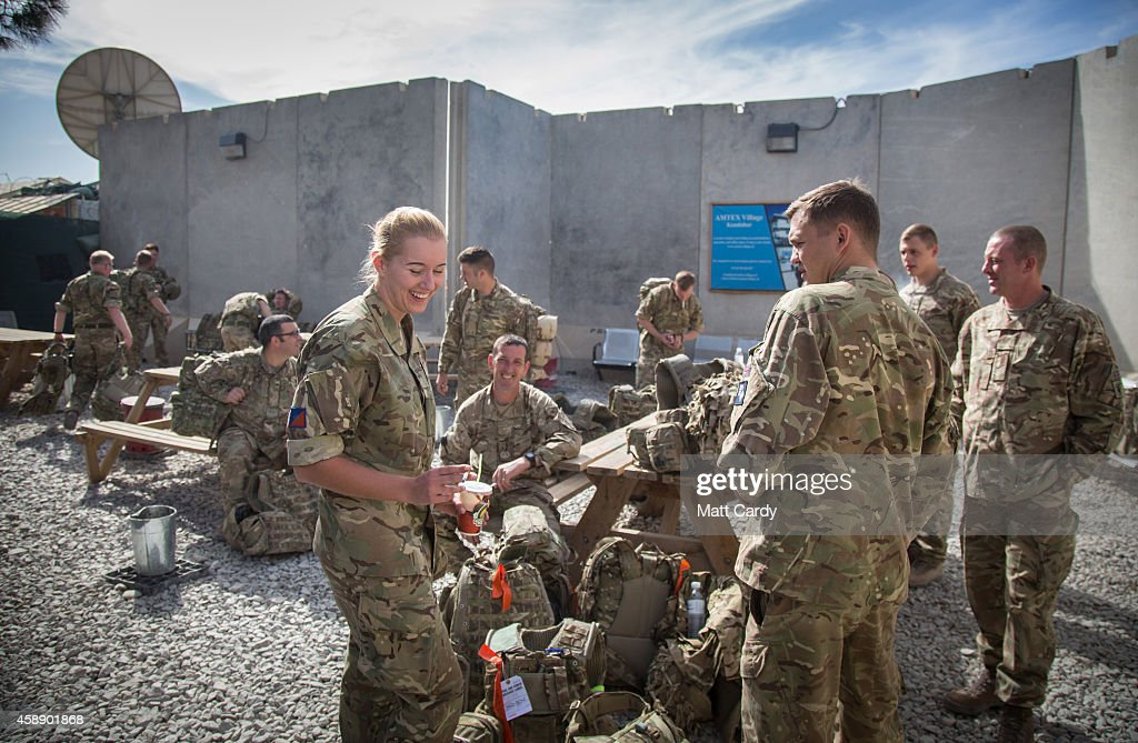 British troops wait to leave the airport terminal to catch a flight home at Kandahar airfield on November 13 2014 in Kandahar Afghanistan Now that...