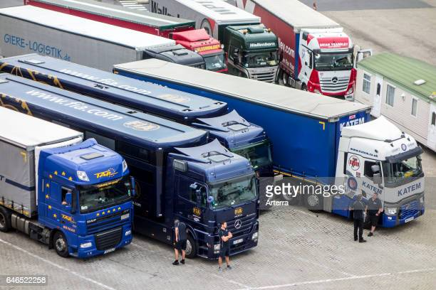British truck drivers waiting in front of lorries at parking