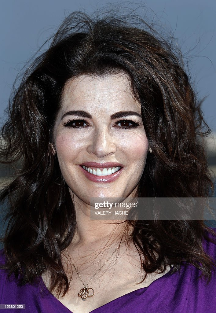 British TV chef Nigella Lawson poses during a photocall for the television show 'Nigellissima' as part of the Mipcom international audiovisual trade show at the Palais des Festivals, in Cannes, southeastern France, on October 9, 2012. AFP PHOTO / VALERY HACHE