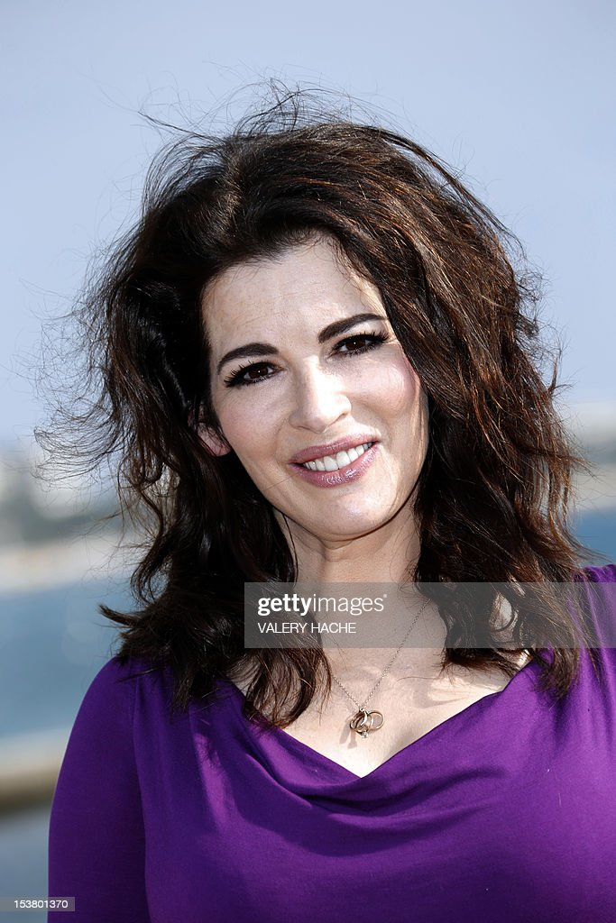 British TV chef Nigella Lawson poses during a photocall for the television show 'Nigellissima' as part of the Mipcom international audiovisual trade show at the Palais des Festivals, in Cannes, southeastern France, on October 9, 2012.