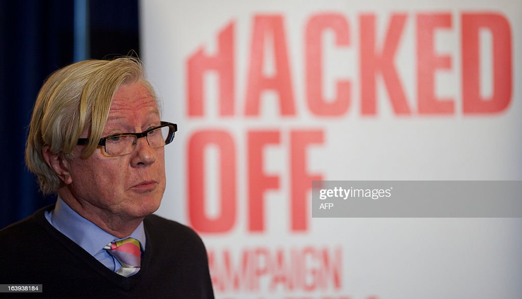 British TV executive Mike Hollingsworth attends a Hacked Off press conference in London, on March 18, 2013, following the cross-party agreement on a new system of newspaper self-regulation that resulted from negotiations sparked by the Leveson Inquiry's review of press standards. Hacked Off, a campaign group that advocates for victims of press abuse, welcomed the cross-party agreement on implementing the Leveson recommendations on press self-regulation.