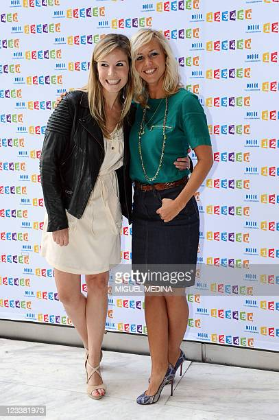 British Tv host Louise Ekland and Enora Malagre pose during a photocall at the France Television headquarters on August 31 2011 in Paris AFP PHOTO...