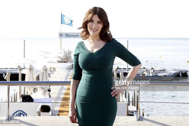British TV personality and food writer Nigella Lawson poses during a photocall for 'Simply Nigella' at the MIPCOM audiovisual trade fair in Cannes...