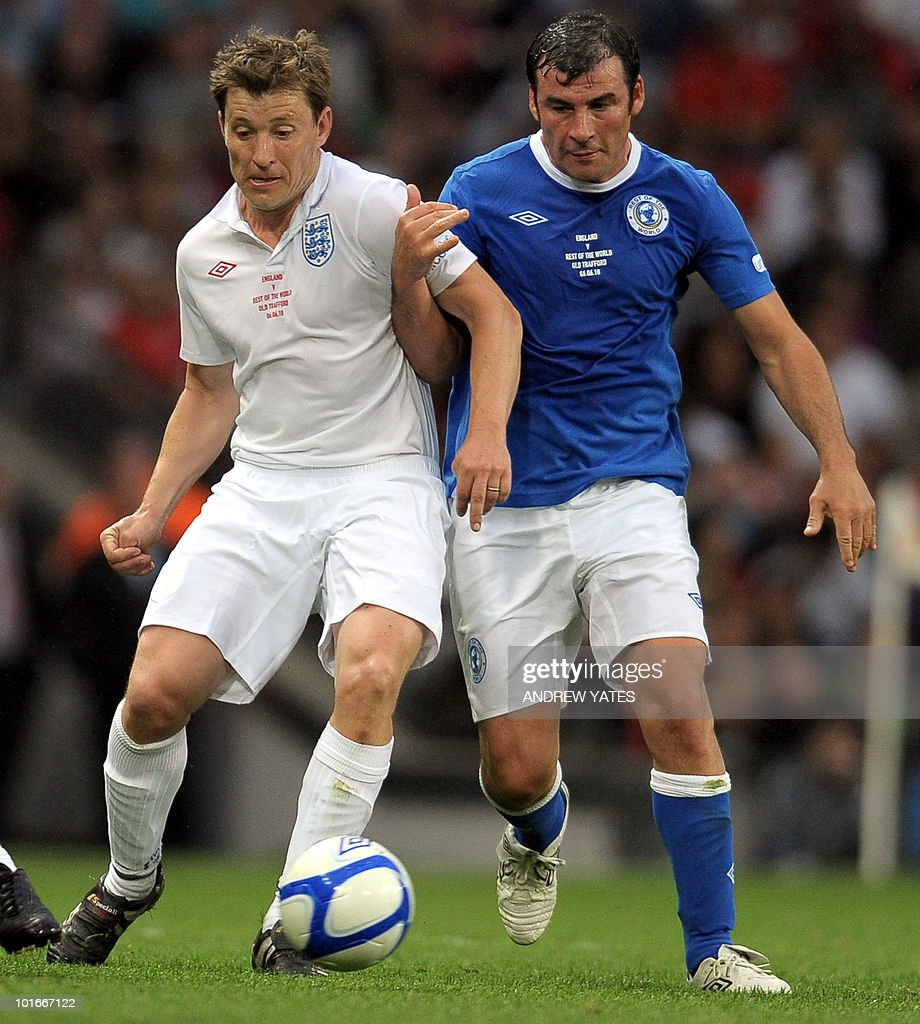 British tv presenter Ben Shephard (L) vies with boxer Joe Calzaghe during the Unicef Soccer Aid charity football match against the Rest of the world at Old Trafford in Manchester, north-west England on June 6, 2010. Soccer Aid is the brainchild of Robbie Williams and all money raised through profits from ticket sales and donations made by viewers of ITVduring the match will go to UNICEF�s invaluable work helping children around the world.