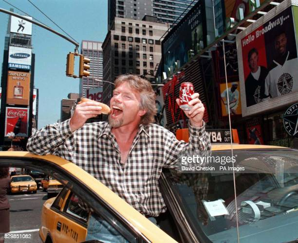 British tycoon Richard Branson enjoys a hot dog and a drink of Virgin Cola in Times Square New York today during preparations for the grand opening...