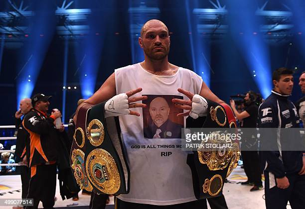British Tyson Fury celebrates after the WBA IBF WBO and IBO title bout against Ukrainian world heavyweight boxing champion Wladimir Klitschko in...