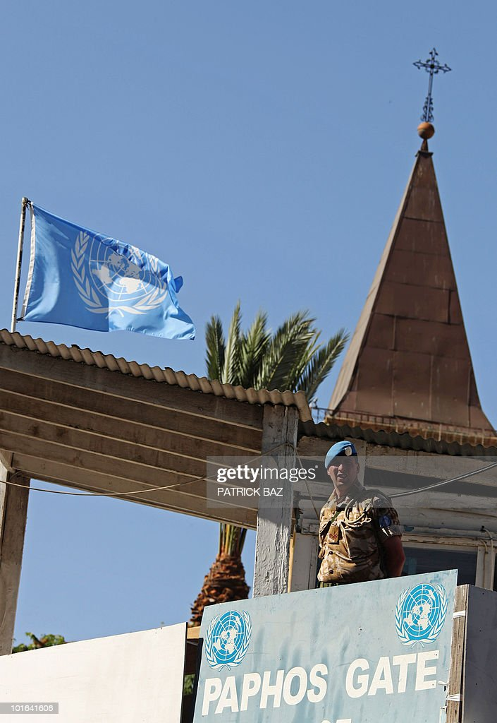 British UN soldiers guard a building in the Paphos Gate neighbourhood of Nicosia, opposite the Latin Church of the Holy Cross, on the Green Line in the divided capital of Cyprus where Pope Benedict XVI celebrated mass on June 5, 2010 on the second day of his visit to the mainly Greek Orthodox east Mediterranean island.