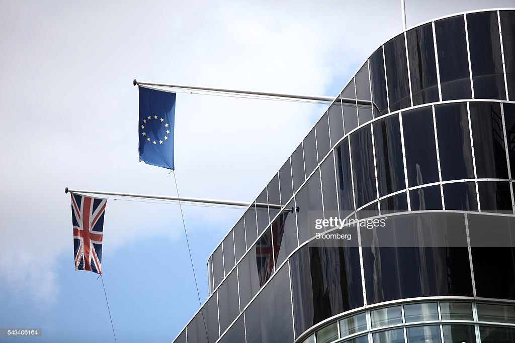 A British Union Flag, also know as a Union Jack, left, and a European Union (EU) flag fly on the side of a building in London, U.K., on Tuesday, June 28, 2016. The pound rose for the first time since the U.K.s vote to leave the European Union, as a recovery in investor appetite for higher-yielding assets seeped through currency markets. Photographer: Chris Ratcliffe/Bloomberg via Getty Images