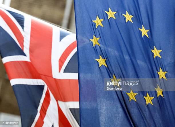 A British Union flag commonly known as a Union Jack left flies next to a European Union flag in London UK on Wednesday Feb 17 2016 German Chancellor...