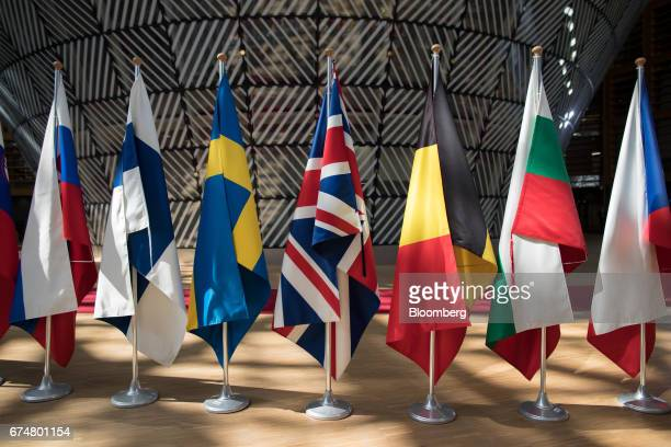 A British Union flag commonly known as the Union Jack center hangs in line with other national flags ahead of a European Union leaders emergency...