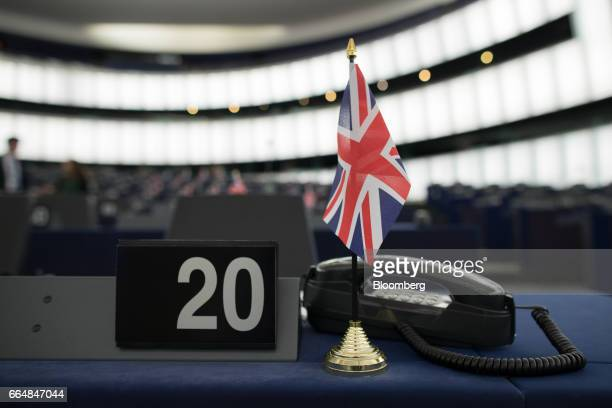 A British Union flag commonly known as the Union Jack stands on the desk of Nigel Farage member of European Parliament and former leader of the UK...