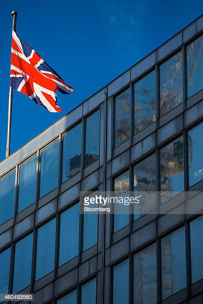 A British Union flag flies from a pole above New Scotland Yard the headquarters of London's Metropolitan Police Service in London UK on Monday Dec 15...