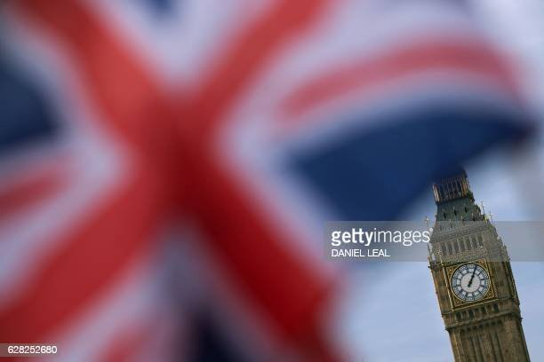 A British Union flag flies near the Elizabeth Tower otherwise known as Big Ben opposite the Houses of Parliament in central London on December 7 2016...